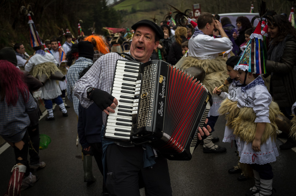 "A man plays acordeon among bellringers during the celebration of an ancient traditional carnival. Zubieta (Basque Country) January 27, 2015. The ""Joaldunak"" (""those who play the bell"") is a character that takes part in the carnival at the villages of Ituren and Zubieta carrying sheepskin and big cowbells tied to their backs, looking for a good new year, a good harvest and to keep away the bad spirits. (Gari Garaialde / BostokPhoto)"