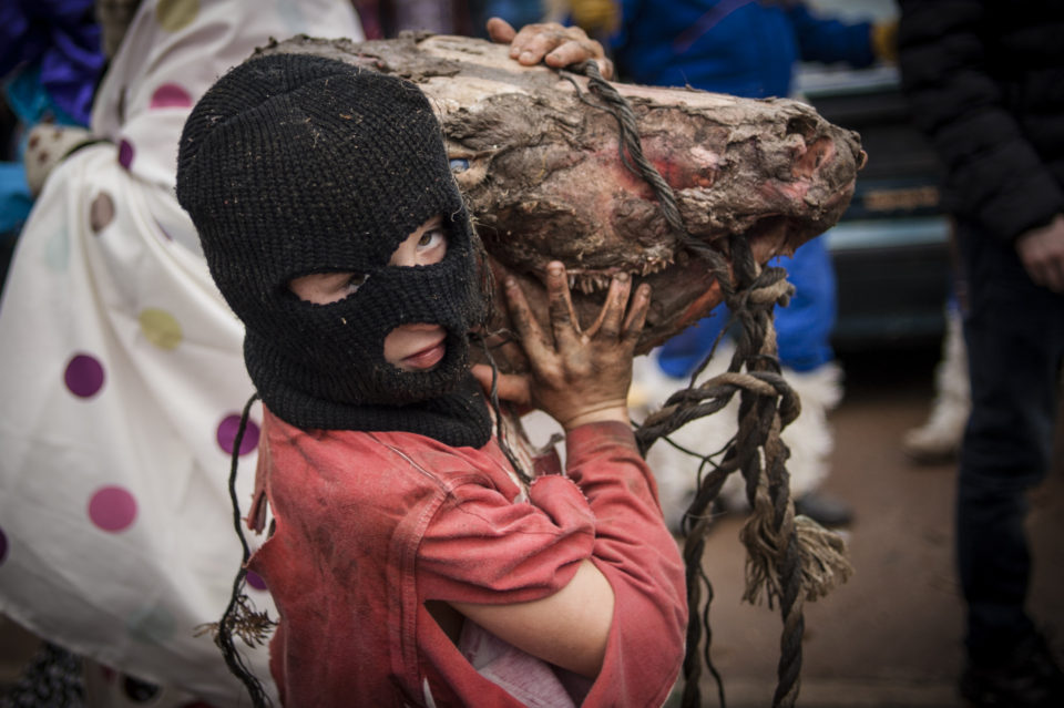 "A masked little boy with a cow head, performs during the celebration of an ancient traditional carnival. Ituren (Basque Country). February 1, 2016. The ""mozorro"" is a character that takes part in the carnival at the villages of Ituren and Zubieta which  have a close relationship with the rural world, forest occupation or hunting.  (Gari Garaialde / BostokPhoto)"