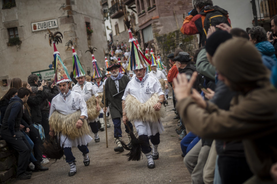 "People dressed up in ""Joaldunak"" (""those who play the bell"") costume perform during the celebration of an ancient traditional carnival. Zubieta (Basque Country). February 2, 2016. The ""Joaldunak"" (""those who play the bell"") is a character that takes part in the carnival at the villages of Ituren and Zubieta carrying sheep furs and big cowbells tied to their backs to wake up the earth, looking for a good new year, a good harvest and to keep away the bad spirits. (Gari Garaialde / BostokPhoto)"