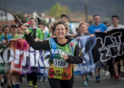 A woman carrying the baton run on the 20th Korrika. (Gari Garaialde / Bostok Photo)