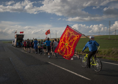 A biker wearing navarre flag closes the Korrika caravan. (Gari Garaialde / Bostok Photo)